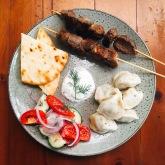 Shaslik, tushpara, salad and flatbread